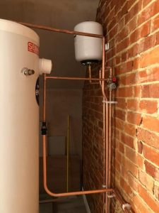 Unvented cylinder and expansion vessel installation in loft, with some neat pipe runs, Henley-on-Thames